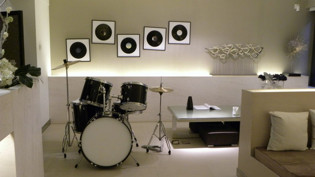 custom basement with drum set and back lit wall decor  - renovation companies