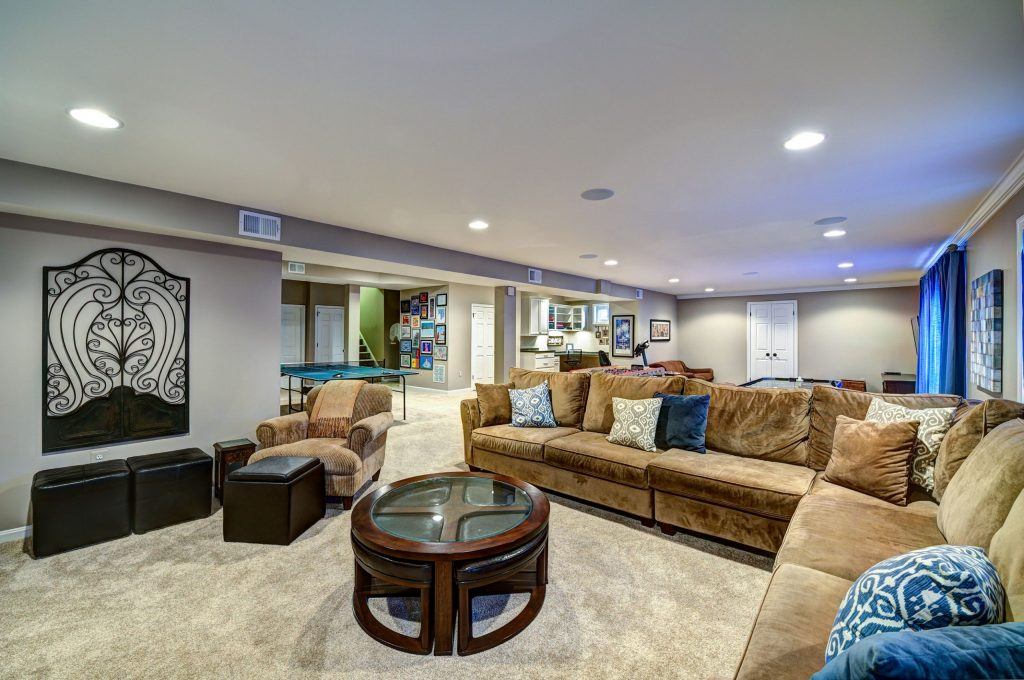 amazing family room with carpet floor and gray wall painting -  basement design ideas