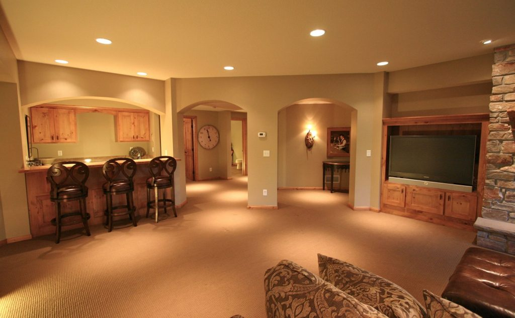 amazing basement renovation with small wet bar and entertainment unit - finishing a basement