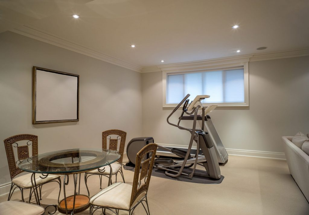 home gym in custom basement - basement remodeling ideas