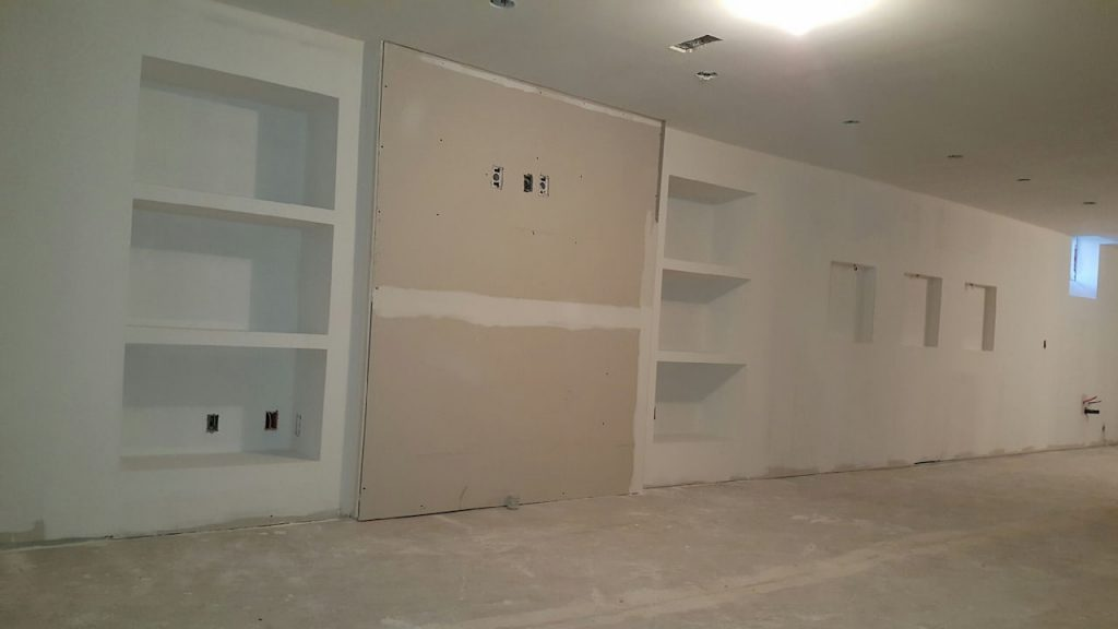 build in storage space in living room of finished basement - basement designers