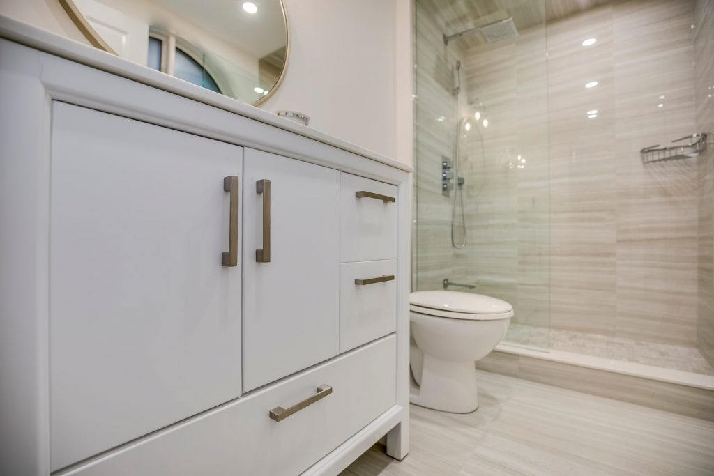 bathroom renovation with white cabinets - basement renovation mississauga