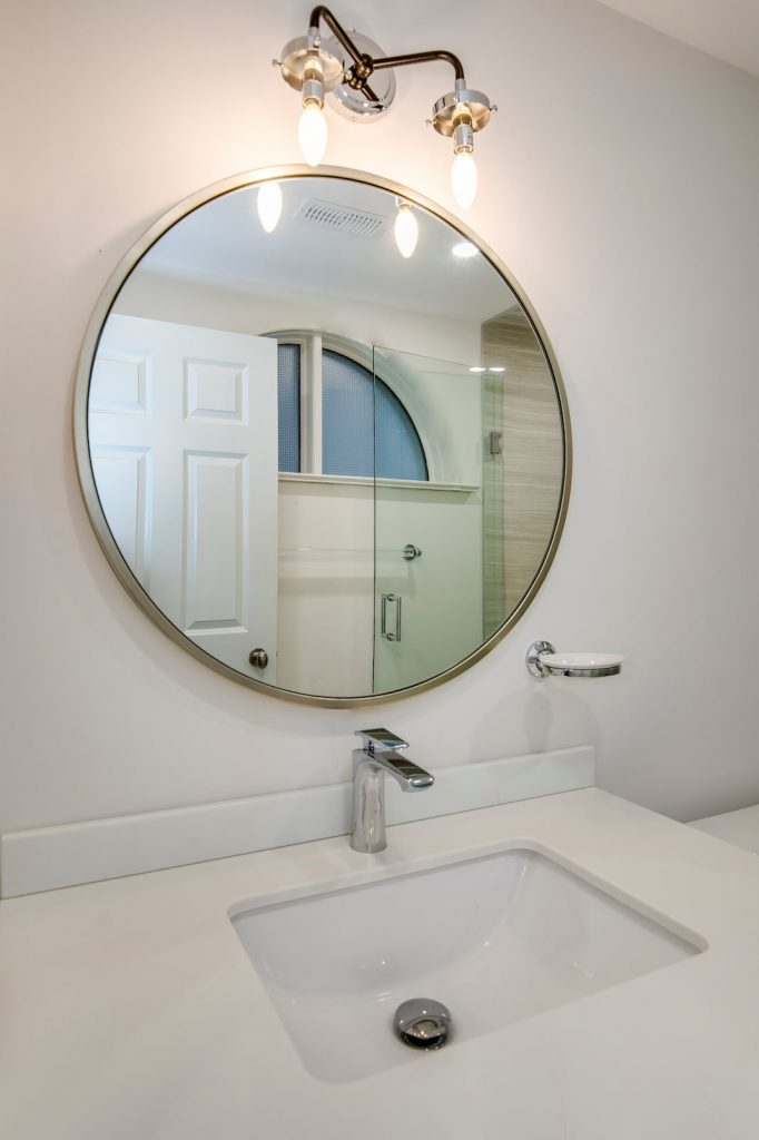 custom bathroom with luxury round mirror - basement renovation thornhill