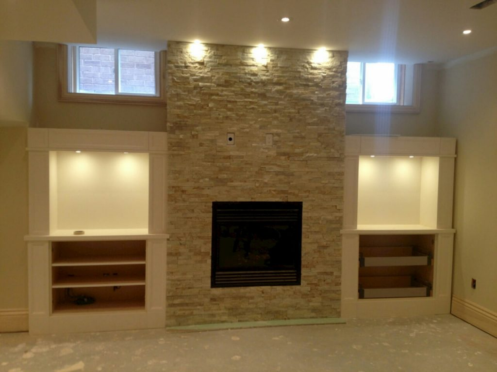 modern basement remodeling with build in storage space - basement renovation milton