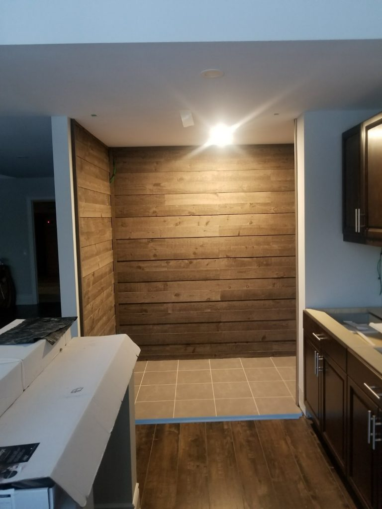 basement kitchen with custom wall decor - basement kitchen renovation