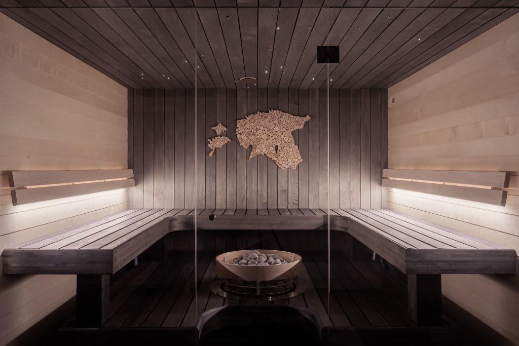 luxury basement sauna with backlit wooden bench - basement renos