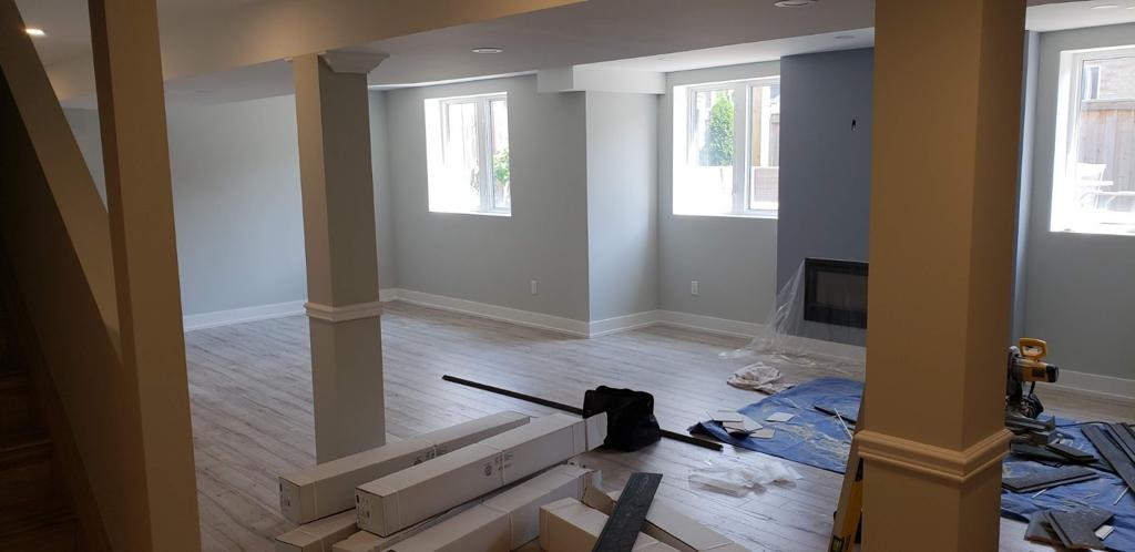 custom Basement Renovations with build in fire place and light blue wall painting ajax