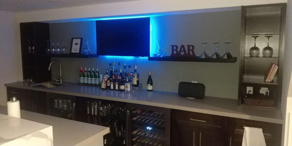 amazing basement custom bar with backlit tv stand and mini fridge - basement ideas bar innisfil