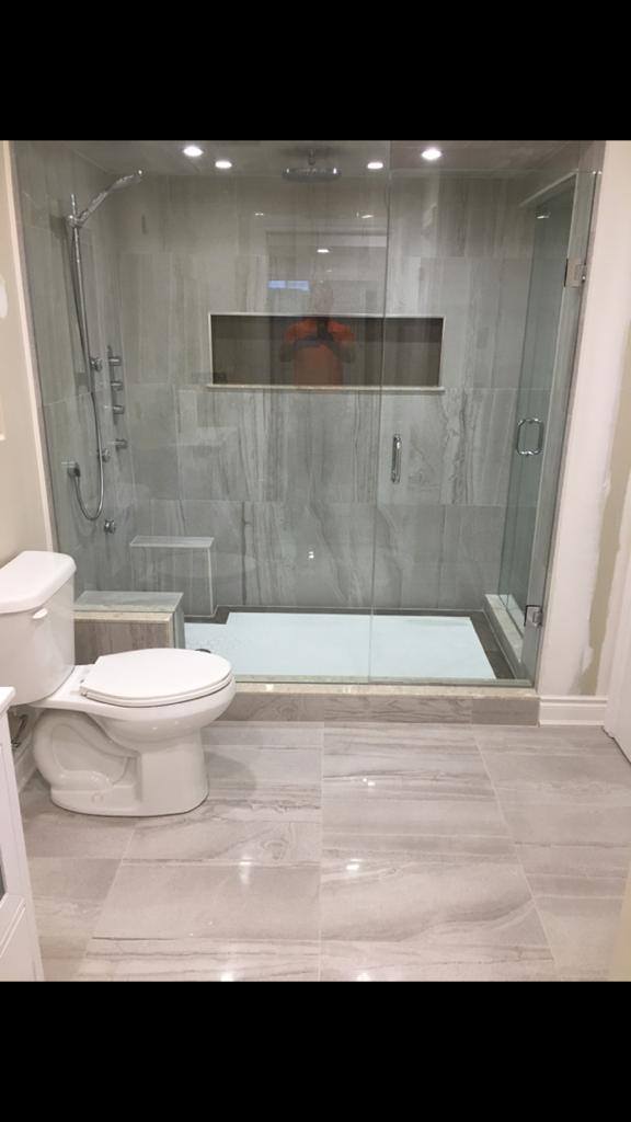 walk in shower in small basement bathroom - basement renovation toronto