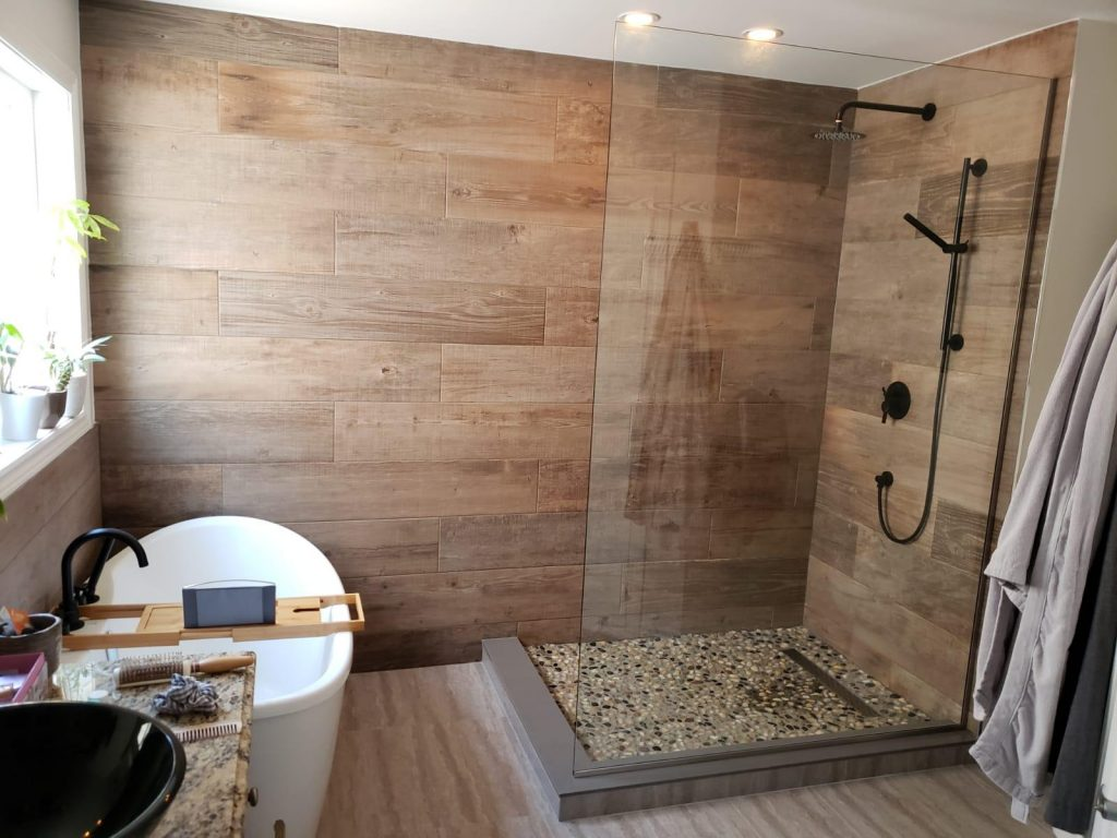 amazing bathroom with walk in shower and freestanding bathtub - basement renos