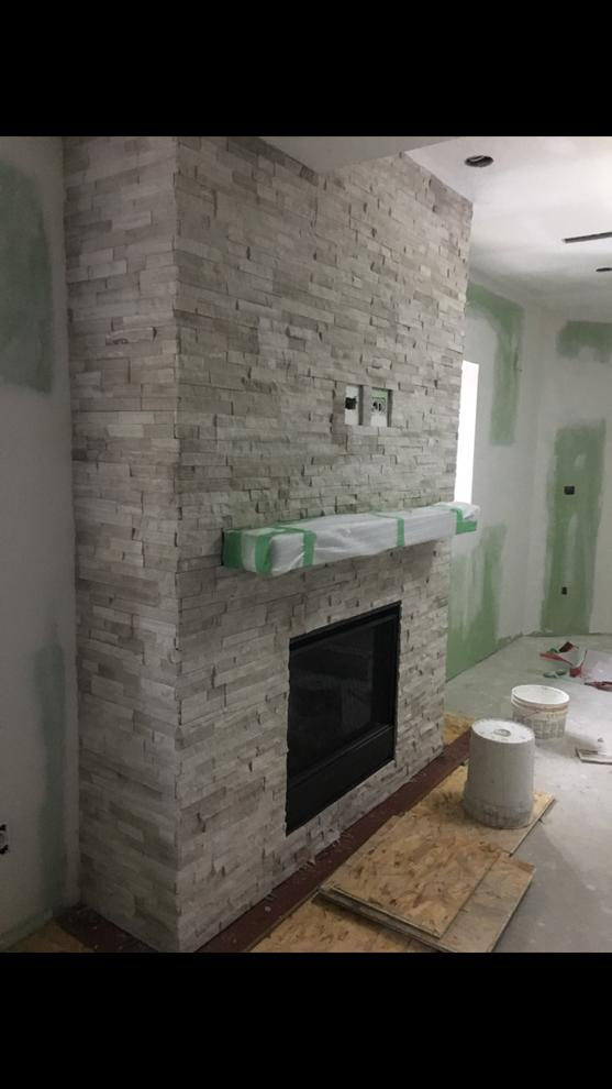 amazing family room with build in fire place and 3d wall decor - basemant design ideas north york