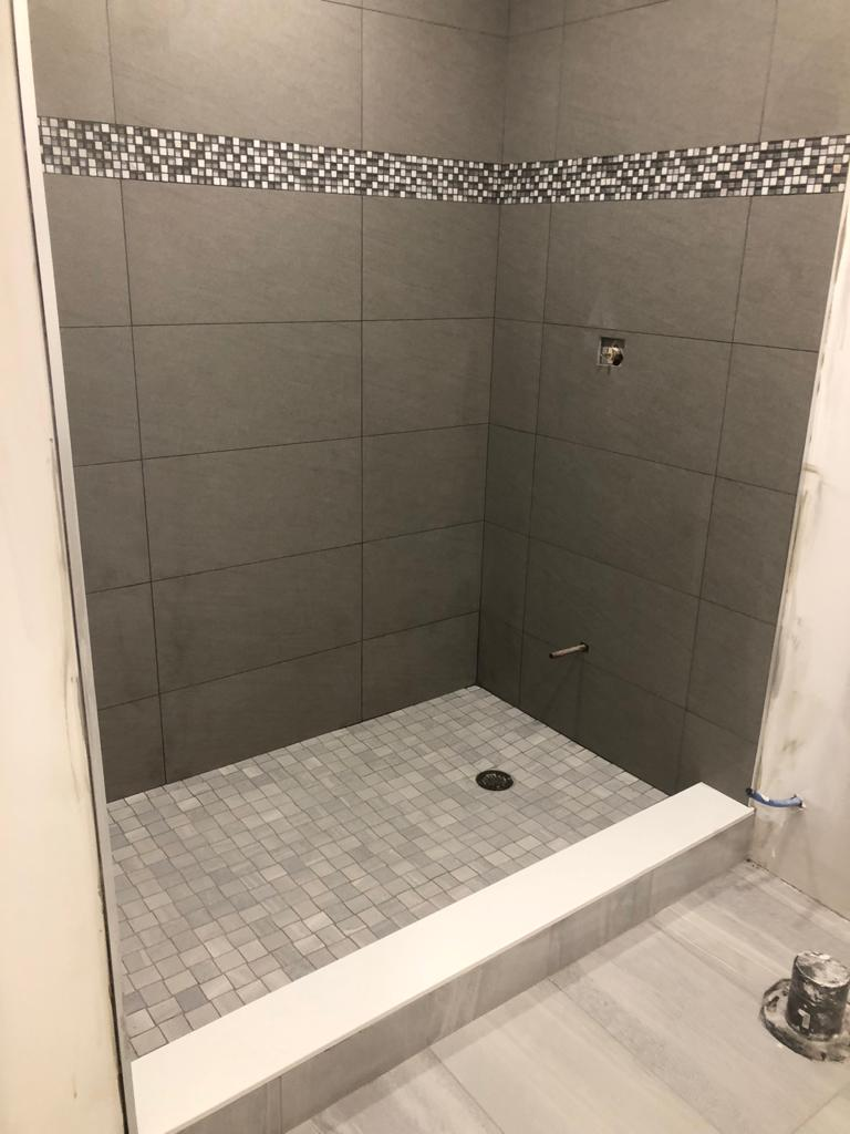 luxury walk in shower in custom basement bathroom - basement renovation toronto