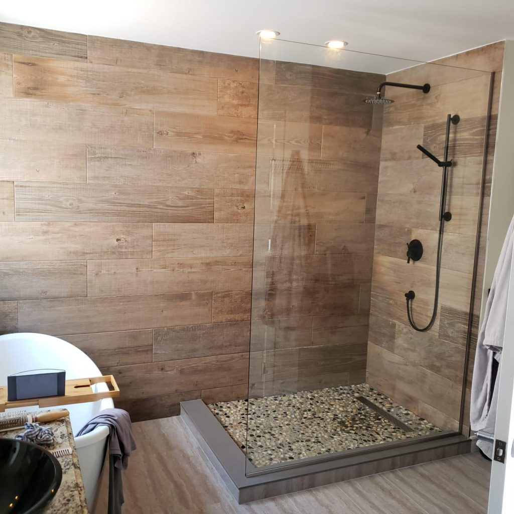 amazing walk in shower with wooden wall panel and freestanding bathtub