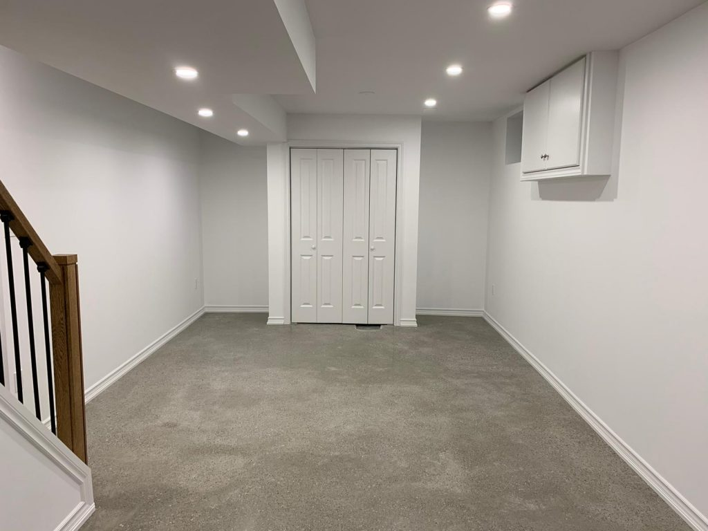build in closet and floor carpet in custom basement - DRV basement company aurora