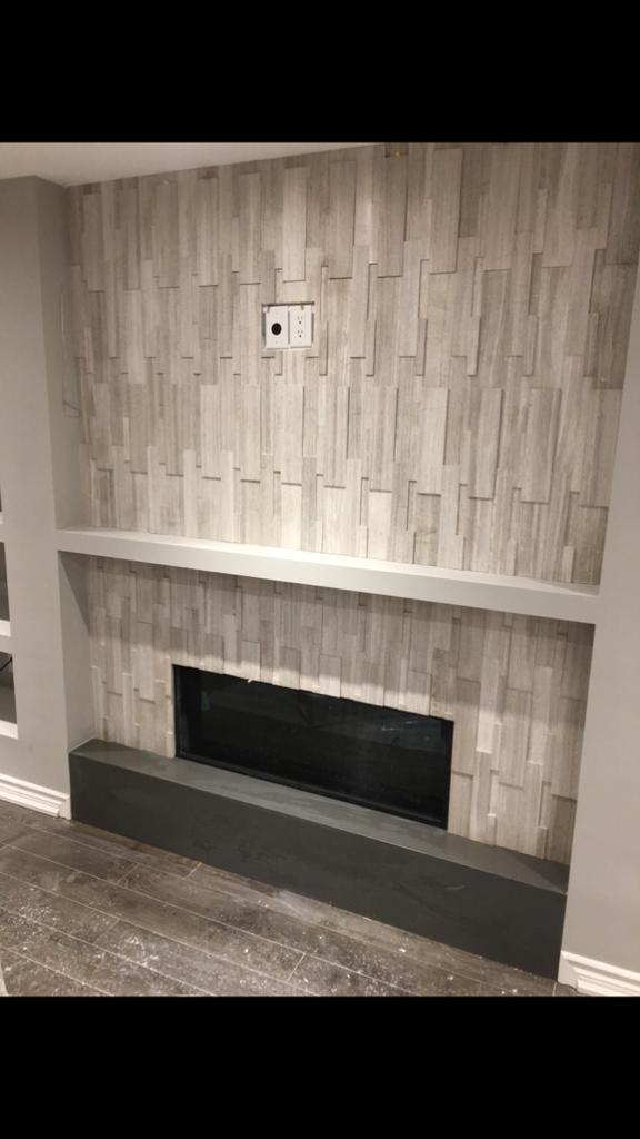 custom entertainment unit with 3d wall decor in amazing basement living room - basement design toronto