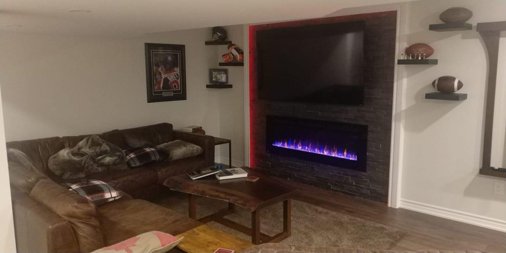 amazing living room with backlit wall decor and build in fire place - basement renovation innisfil
