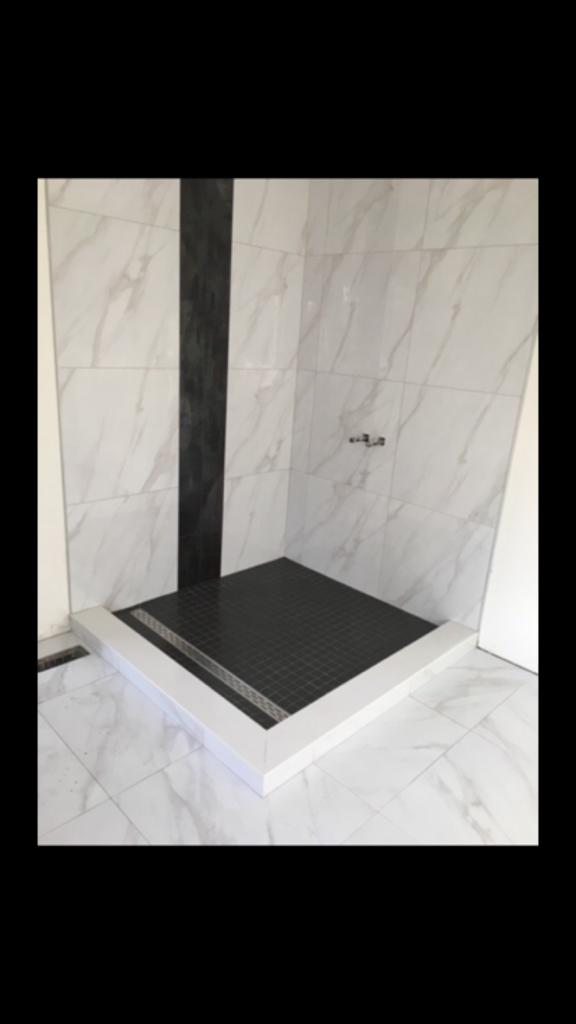 custom walk in shower with marble tile decor - walkout basement remodeling aurora