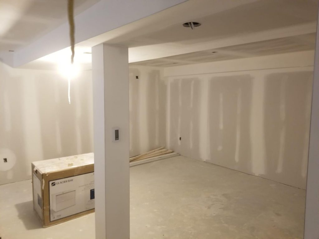 finishing installation of dry wall in custom basement - basement renovation barrie