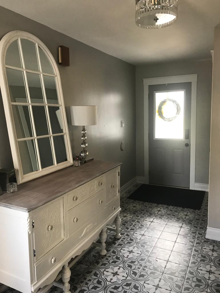front door hallway with green wall painting and decor floor tiles - home renovation by DRV basements barrie