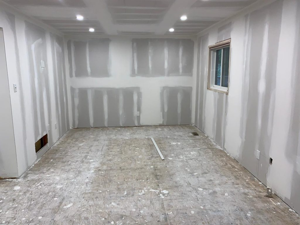 unfinished basement in progress of remodeling - basement remodeling ideas