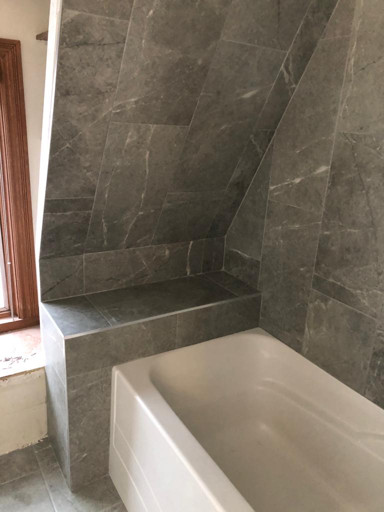 gray marble wall decor in amazing bathroom - DRV basements renovation companies