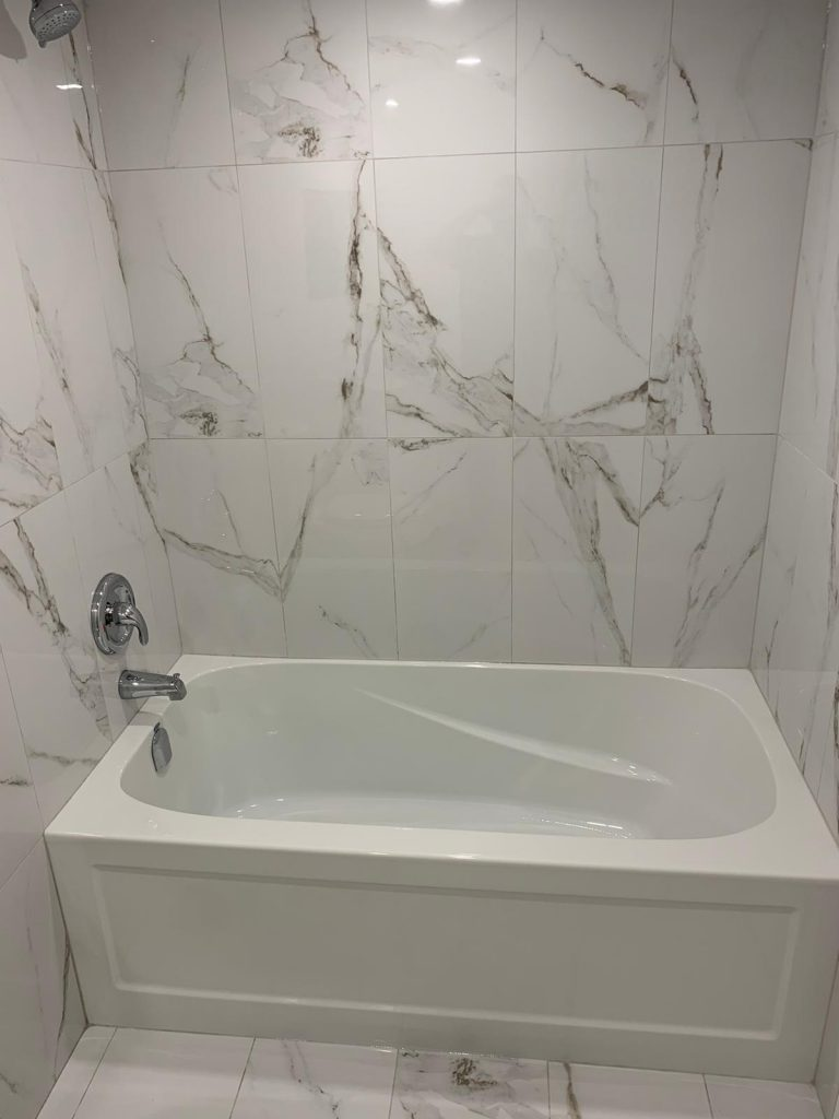 small bathroom with marble wall decor - basement finishing