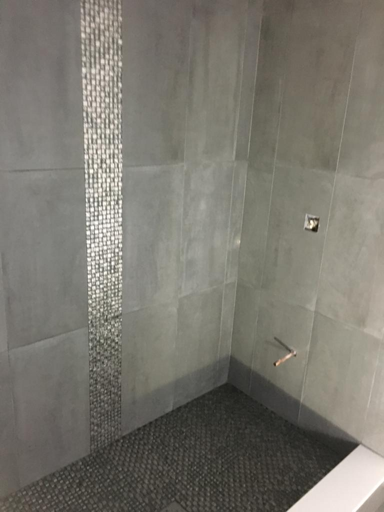 custom marble tile wall decor in amazing shower - finishing a basement