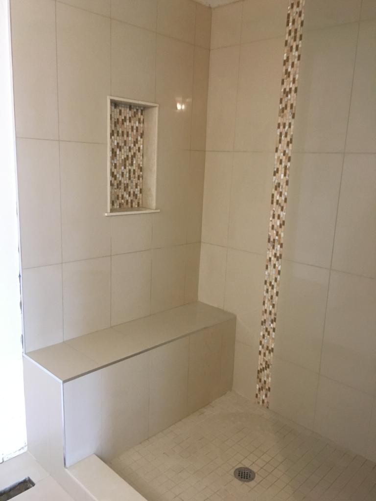 walk in shower with build in storage and siting banch - finishing a basement king city