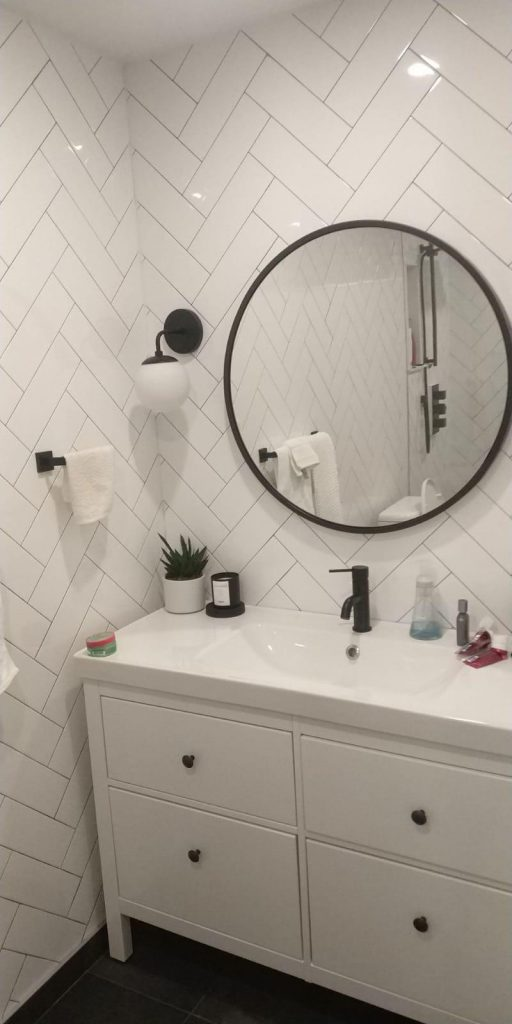 basement bathroom with wall mirror and white vanity -basement renovation aurora